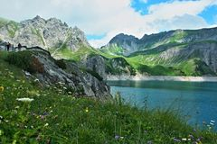 Austrian Alps-view on the lake Lunersee and mountains Ratikon stock photos