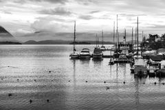 View of a lake marina with stormy clouds. Black and white photo Stock Images