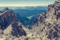 View of a lake through mountain pass. Molveno under Brenta Dolomites Royalty Free Stock Images