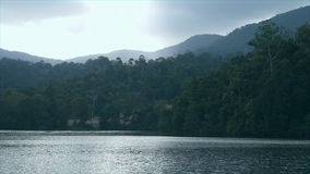 View of lake and mountain at reservoir stock footage