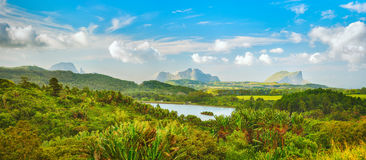 View of a lake and mountains. Mauritius. Panorama Stock Photo