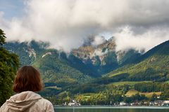 View of the lake near St. Wolfgang with a woman looking at the A royalty free stock images