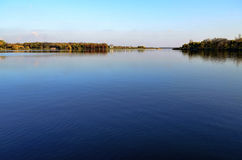 View on the lake in Pantelimon park, Bucharest. Water and blue sky landscape Royalty Free Stock Photos