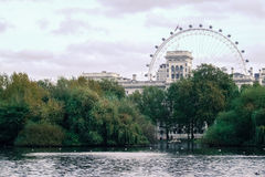 View with lake and park, London Eye in background. With cloudy weather royalty free stock image