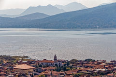 View of Lake Patzcuaro in Michoacan Mexico. The scenic view of Lake Patzcuaro from a hill of the village of San Jerónimo Purenchécuaro, Michoacan, Mexico Stock Photography