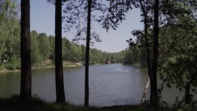 View of the lake from the shore stock video footage