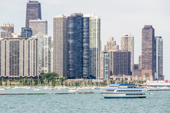 View from the lake side on the part of Downtown's Skyscrapers in Chicago. In the low right part of this image is a tourist ship with blue top that is travels on Stock Photo