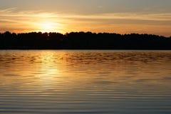 Sunrise. View on a lake during sunrise Stock Photos