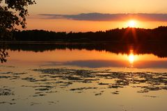 Sunset. View on a lake during sunset Stock Photography