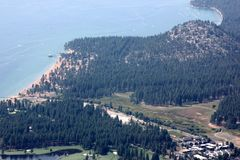 View of Lake Tahoe, buildings and shoreline from upper deck of Heavenly Gondola Stock Images