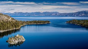 Lake Tahoe West shore view. View of Lake Tahoe from near Emerald Bay, California, USA, including Fannette Island, in the end of the winter of 2018, covered with stock images