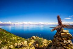 Lake Titicaca and cross from isla de Sol in Bolivia Stock Image