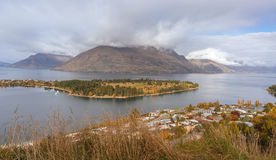View of Lake Wakatipu and Queenstown`s Kelvin Heights. A landscape view on Lake Wakatipu and central suburbs of Queenstown, Otago, South Island, New Zealand Royalty Free Stock Image