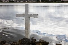 Cross on the lake. View of  a lake with a white cross Stock Images