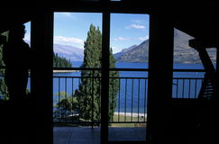 View of lake through window. A beautiful view of Lake Wakatinu through a window from a room at a hotel in Queenstown, New Zealand Stock Photo