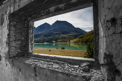 A view on the lake. View from a window in an abandoned building in the italian alps Royalty Free Stock Photography