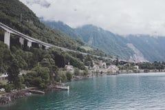 View on lake Zeneva and mountains, city Montreux, Switzerland, Europe. Montreux, Switzerland - June 30, 2017: View on lake Zeneva and mountains, Switzerland royalty free stock photos