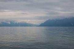 View on lake Zeneva and mountains, city Montreux, Switzerland, Europe. Summer landscape, sunshine weather, dramatic blue sky and sunny day royalty free stock photo