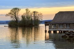 View of the lake Zug in the spring during sunset. Town of Zug, canton of Zug, Switzerland. View of the lake Zug in the spring during sunset. Old residential Royalty Free Stock Image