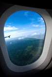 View of land from aircraft window Stock Photo