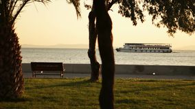 View from land and ferry goes to station. stock footage
