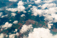 View of  land, fields, and clouds from above Royalty Free Stock Photos