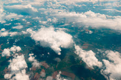 View of  land, fields, and clouds from above Stock Images