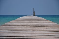 View from landing stage with endless ocean and sky royalty free stock photo