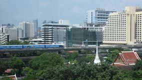 View landscape and cityscape of bangkok city with BTS skytrain at Thailand. BANGKOK,THAILAND - MAY 13 : View landscape and cityscape of bangkok city with BTS stock video footage