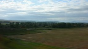 View landscape and cityscape of countryside from train running. From France go to Germany stock video