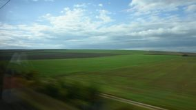 View landscape and cityscape of countryside from train running. From France go to Germany stock video footage