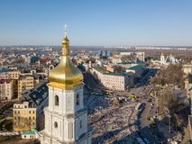 View landscape in Kiev with St. Sophia bell tower and people sightseeing at Sofiiska square. Kiev City skyline aerial view at drone. Top view on Sophia Square Royalty Free Stock Photos
