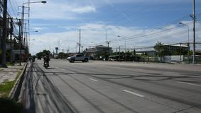 View landscape of traffic road and vehicle drive u-turn at street. SAMUT PRAKAN, THAILAND AUGUST 9 : View landscape of traffic road and vehicle drive u-turn at stock footage