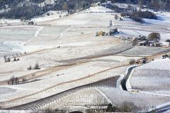 View of Langhe hills with snow and the village of La Morra Piedm Royalty Free Stock Photos