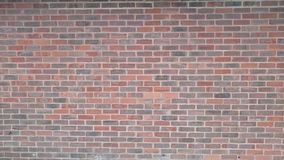 View of a large brick wall inlandscape. A large recent brick wall in capstone park UK taken during a cloudy day in the UK in spring mortar pattern grouting grout Royalty Free Stock Images