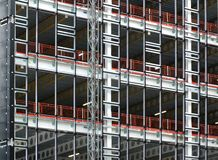 View of a large building development under construction with steel framework and girders supporting the metal floors royalty free stock photo