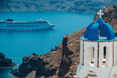 View of a large cruise liner from the island of Santorini. View of a large cruise liner at the sea from the island of Santorini Royalty Free Stock Photos