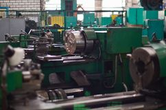 View of a large metal industrial machine in the shop for processing iron products. Industrial Tourism royalty free stock photo