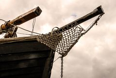 A view of a large wooden schooner`s bow under the cloudy sky. royalty free stock photos