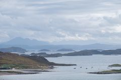 View of the largely uninhabited Scottish islands known as the Summer Isles taken from the mainland, north of Polbain. View of the largely uninhabited Scottish stock image