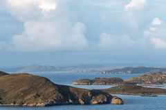 View of the largely uninhabited Scottish islands known as the Summer Isles taken from the mainland, north of Polbain. View of the largely uninhabited Scottish royalty free stock image