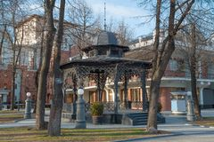 View larger forged arbor in the Hermitage Garden. In spring, Moscow Royalty Free Stock Photos
