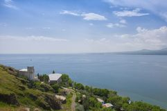 View of the largest source in the entire Caucasus - Lake Sevan. Blue sky and horizon line. Armenia. View of the largest source in the entire Caucasus - Lake Stock Images