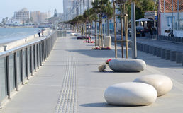 View of Larnaca seafront with palm trees and stone shaped benches Stock Photography
