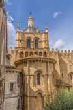 View of lateral facade and cupola of the gothic building of Coimbra Cathedral, Coimbra city and sky as background. Coimbra / Portugal - 04 04 2019 : View of royalty free stock photography