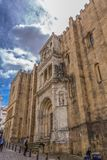 View of lateral facade of the gothic building of Coimbra Cathedral, Coimbra city and sky as background, Portugal. Coimbra / Portugal - 04 04 2019 : View of royalty free stock images