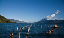 View of Laut Tawar Lake. With fishing activities that were catching fish in a cage Stock Photos