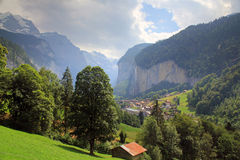 View at the Lauterbrunnen valley with the village Lauterbrunnen and mountains. View at the Lauterbrunnen valley with mountains, waterfalls, and the beautiful royalty free stock photo