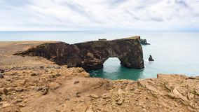 View of lava arch on Dyrholaey cliff in Iceland. Travel to Iceland - view of lava arch on Dyrholaey cliff, near Vik I Myrdal village on Atlantic South Coast in stock images