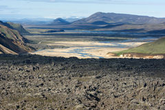 View of lava field, valley and river in a distance in Landmannal Royalty Free Stock Photos
